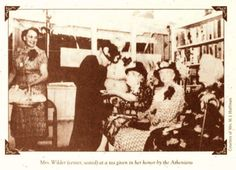 Laura Ingalls Wilder (seated, center) at a tea given in her honor.