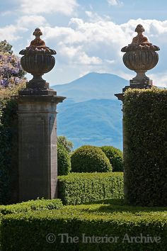 Monte Amiata dominates the landscape, seen here through the gate of the lemon garden at La Foce / The Villa La Foce is set within beautiful landscaped gardens with spectacular views over the Val d'Orcia in Tuscany. Bought by Antonio and Iris Origo in the 1920's the gardens where created by Iris and the English architect Cecil Pinsent.