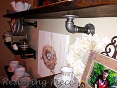 Using plumbing pipes as brackets for a shelf~