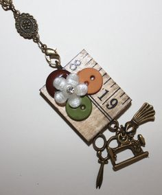 Seamstress - Bronze Romantic Floral Wood Yard Stick Piece with Buttons Necklace With Charms.