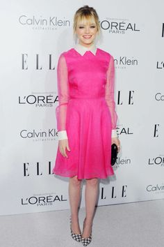 In a Valentino dress and Ferragamo pumps at the 19th Annual ELLE Women In Hollywood Celebration. See all of Emma Stone's best looks.