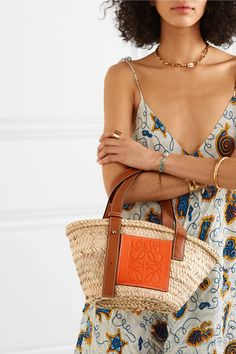 Raffia, tan and orange leather Open top This product is handcrafted from natural materials and therefore the exact color and size may differ from that pictured Weighs approximately Made in Spain Orange Leather, Tan Leather, Little Boy Costumes, Loewe Bag, Basket Bag, Orange Crush, Cloth Bags, Small Bags, Fashion Details