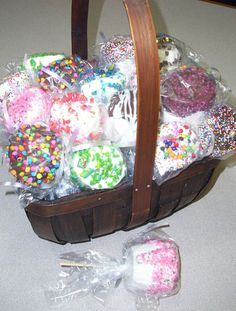 Good idea for fundraiser or bake sale - giant marshmallows dipped in white or dark chocolate and sprinkles.