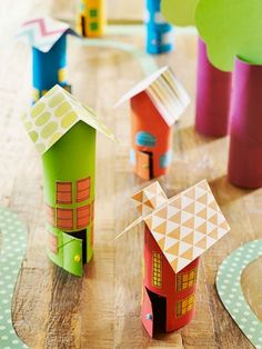 Turn your used toilet paper rolls into an imaginary town for your tot. All you need is paint, scissors, scrapbook paper, markers, and glue!