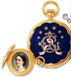 King Christian IX and Queen Louise of Denmark's yellow gold Patek Philippe pocket watch. 45 rose-cut diamonds form the intertwining letters L and C, with a ribbon crossing them with the dates, 1842 and 1867. One side of the case is enameled with a portrait of Louise: