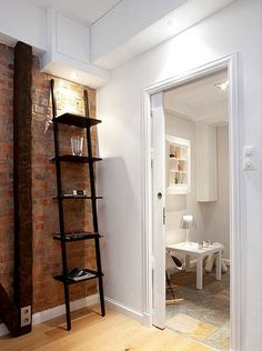 Exposed brick wall + decorative ladder - me like!