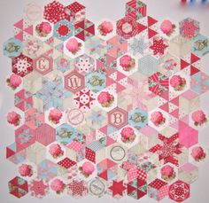 Hexagon quilt by Gayle Brindley, with different hexagon shapes, inspired by the Candied Hexagons quilt.  We love the use of fussy-cut flowers in some of the blocks.