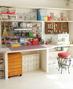 """Another photo from """"24 Creative Craft Room Storage Ideas,"""" this lovely craft room with the card-catalog-like piece no longer connects at the source given. Love the printer's drawer, too!"""