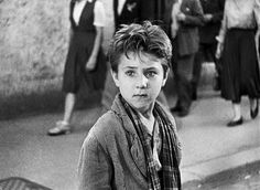 "From ""Bicycle Thieves"" (1949) (""Ladri di Biciclette""), an influential film in Italian Neorealism. This is the moment when shock registers on the face of Bruno Ricci (Enzo Staiola) as he realizes that his father Antonio (Lamberto Maggiorani) has become the next thief, a continuation of the vicious cycle of poverty and crime."