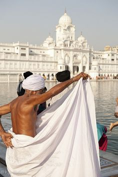 Bathing at the Golden Temple, India, Asia. Travel to India with ROYAL EXPEDITIONS DMC. A member of GONDWANA DMCs, your network of boutique Destination Management Companies across the globe. www.gondwana-dmcs.net
