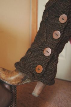 cut the arm of an old sweater and sew on buttons...cute!!!
