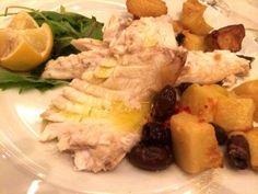 branzino al forno con patate e olive
