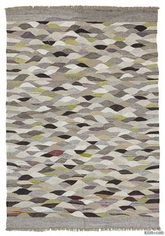 New kilim rug woven in Turkey using recycled yarn unravelled from old kilims.