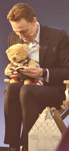 Tom reading to his Thor bear. He is darling
