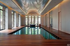 designed by Gabhan O'Keeffe, the swimming pool, lined in bronze-color glass tile, is surrounded by an iroko-wood deck