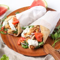 Homemade gyros will never be the same after you try these Chicken Gyros with Watermelon Rind Tzatziki! Whole Wheat Pita Bread, Greek Dinners, Tzatziki Recipes, Chicken Gyros, Watermelon Rind, Sliced Tomato, Food Waste, Main Dishes, Stuffed Peppers