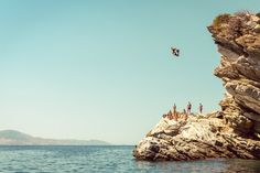 Dozens of dives to be had in Santorini, Greece. Or for more thrills take a BASE jump from the cliffs above Navagio Beach, Zakynthos. Beaches In The World, Places Around The World, Around The Worlds, Diving World, Advertising History, Cliff Diving, Red Beach, New York Life