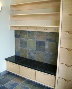tile behind the coat hanging area? like this idea, then possibly have lots of wood for a more outdoorsy look.