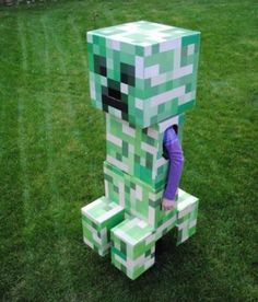 "Minecraft Creeper DIY costume from ""These Costumes Prove Crafters Win Halloween!"" at crochetersanonymous.com  Before you sit down to enjoy these costumes, get your coffee or tea and perhaps some rations. It took me forever to write this because I kept looking, and looking, and looking… #halloween #costume #diy #minecraft"