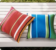 How to make your own outdoor pillows using vinyl shower curtains or tablecloths.