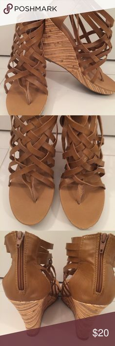 Brown leather wedge Gently used brown strappy wedge.  Worn twice. Qupid Shoes Wedges