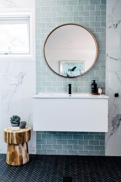 Home Interior Colour blue and marble tile bathroom + bathroom design + floating vanity + round bathroom mirror Marble Tile Bathroom, Laundry In Bathroom, Bathroom Renos, Bathroom Interior, Modern Bathroom, Master Bathroom, Bathroom Ideas, Minimalist Bathroom, Small Bathrooms