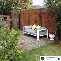 Here's a visual feast! Our 'Fireworks' rusty steel fence screening panels (slightly customised) feature between upright rusty railway sleepers. Image courtesy of ChalkHorse Design. visit www.entanglements.com.au/