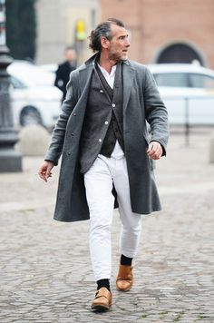 White pants, black socks, camel leather shoes. Gray on gray on gray layers.
