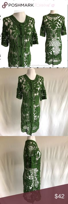 "Betsey Johnson Green Lilly Crocheted Tunic Duster Betsey Johnson Green Lilly Crocheted Tunic Duster. Wow! Green button front tunic in cotton crochet with floral cutout design. Embroidered covered buttons. This is perfect for any Betsey collector or lover. Good used condition. All knit is in order and no pulling that I can see (and I looked many times) Labeled O/S but best for a Small/Medium. Can fit XS but will be more loose. Photos are best descriptors. Chest 17""(flat) Length 35"" Betsey…"