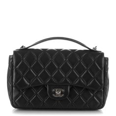 2218f1997f3c This is an authentic CHANEL Lambskin Quilted Medium Easy Carry Flap in Black.  This stunning
