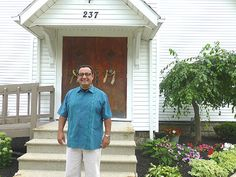 PASTOR ALFRED De La Cruz Jr. stands in front of Harvest Time International Ministries at 237 George St. The congregation is committed to imp...