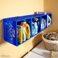 If you don't have cabinets or shelves in your tiny laundry room, buy inexpensive plastic crates at a discount store and create your own wall of cubbies. Screw them to the wall studs using a fender washer in the upper corner of each crate for extra strength. The crates hold a lot of supplies, and they keep tippy things like your iron from falling over. Here are some more ideas for small space storage solutions.