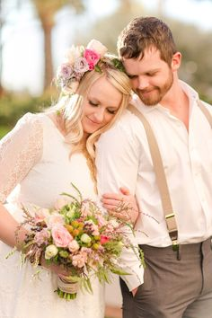 Try couple looking down at bouquet and then reposition bride behind/infront and groom look away/bride looking at camera