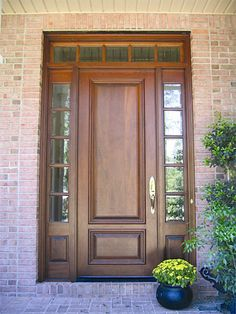 "Estate Exterior Wood Front Entry Door Style DbyD-1017.  This simple Front Exterior Entry features a Mahogany Solid Style ""C-2"" Door with two TDL Style ""C-2"" Sidelites and a 5 Lite TDL Transom.  The glass is Clear Tempered Beveled Glass.  Doors by Decora stained this Entry in Traditional Mahogany.  The hardware chosen is Baldwin Blakely in Bright Brass Finish."