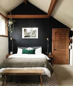 Black wall with wood accessories and white bedding. create the look at: http://www.naturalbedcompany.co.uk/