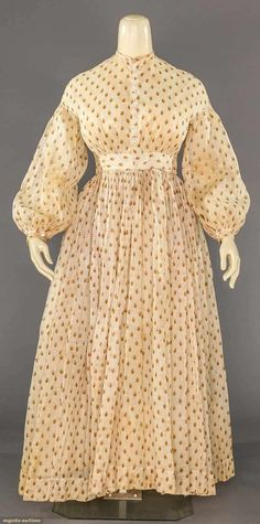 """1860s brown-on-cream semi-sheer voile dress. Turned self-hem of about 2.5"""". Augusta Auctions."""