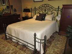 Gorgeous queen sized bed with frame in a bronze metal. Metal beds are so popular because they can be used with a multitude of different style bedrooms. Retails for just over $400 new without the frame!  Arrived: Thursday September 8th, 2016