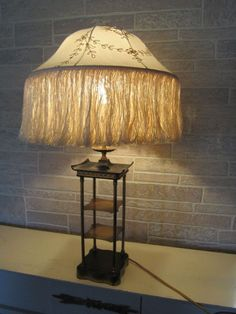 Vintage  Mid century hollywood regency pagoda shelf asian/oriental table lamp, $249.98 (http://www.famousturtletreasures.com/mid-century-hollywood-regency-pagoda-shelf-asian-oriental-table-lamp/)