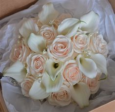 Bouquets With Lilies | Contemporary bouquet of Vendela roses with ivory calla lilies, pearls ...