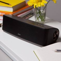 Edifier Bric Connect portable bluetooth speaker. A light speaker perfect for taking anywhere. Can be plugged in or has the option of batteries. Includes a remote control.