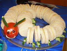 Ψωμί για τόστ  αλλαντικά - τυρί  βούτυρο ή μαγιονέζα  ντομάτα ολόκληρη για το κεφάλι  αγγούρι για κεραίες και πόδια  ελιά για μάτια  μαγι...