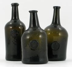 A sealed and dated wine bottle, applied with a crested monogram 'JSH' and the date 1788, and two other sealed and monogrammed wine bottles, all 18th century, one extensively cracked, 27cm max. (3) Estimate: £300 - 500 - Hammer Price £ 1,300