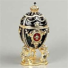"Russian Faberge Egg Jewelry Box  with fleur de lis symbol.   The English translation of ""fleur-de-lis"" is ""flower of the lily."""