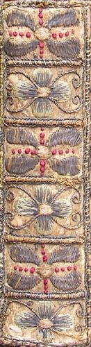 Spine embroidered with floral decoration. 17th-century English embroidered binding (Y.a.1617.1(1))  17th-century English embroidered binding. The spine is decorated florally. FromOf the imitation of Christ (London, 1617).