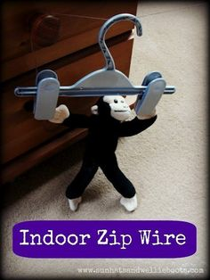 Use a clothes hanger and string to make an indoor zip wire for your kid's favorite toy. | 37 Activities Under $10 That Will Keep Your Kids Busy All Winter
