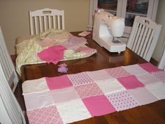 A Bridesmaids dress, cut up, turned into a baby quilt, then given to the bride during her baby shower.