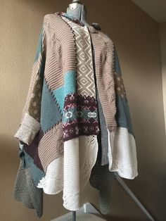 Upcycled Warm Winter Wrap, Sleeping on the Snow Patchwork Sweater poncho This is mixed raimie Cotton with some polyester One size 34 long from center back to Hemline 25 from top of shoulder to sleeve cuff 31 front measured from button to Hemline