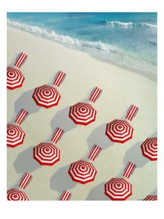 Red and white - parasols and towels - on the beach
