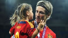 Fernando Torres of Spain speaks with his daughter Nora Torres following victory in the UEFA EURO 2012 final against Italy  ©Getty Images