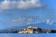 #aspettami #spiaggia #bellissima #bellezza #blu #edilizia #scogliera #nuvola #costa #europa #vacanze #isola #italiano #italia #luce #faro #mediterraneo #mattina #montagna #napoli #natura #roccia #mare #cielo #pietra #estate #turismo #viaggi #muro #acqua #biancoLandscape of Monte di Procida, Naples, Italy, from the sea